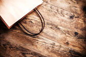 Empty bag brown wooden background. — Stock Photo