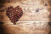 Heart symbol from coffee beans. — Stock Photo