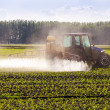 In spring, the corn is sprayed on the tractor. — Stock Photo #48165445