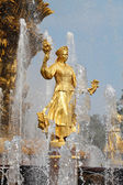 Girl with a fountain of friendship Lithuania — Stock Photo