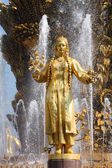 Girl with a fountain of friendship Turkmenistan — Stock Photo