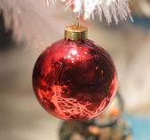 Red ball on Christmas tree — Stok fotoğraf