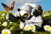 Astronaut and a butterfly — Stock Photo