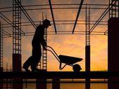 The worker with a wheelbarrow — Stok fotoğraf