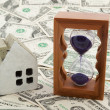 Stock Photo: House model and hourglass