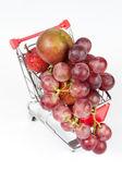 Fruits in shopping cart — Stock Photo