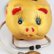 Stock Photo: Piggy bank and stethoscope