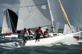 Team skipper on yacht at regatta — Stock Photo