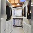 Modern wardrobe on garret - Stock Photo