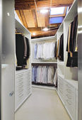 Modern wardrobe on garret — Stock Photo