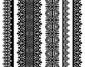 Set of black lace borders isolated on white — Stock Vector