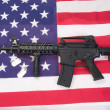 M4A1 assault rifle with blank dog tags on us flag — Stock Photo #12620717