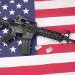 M4A1 carbine with blank dog tags on us flag — Stock Photo