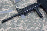 US Army M4A1 carbine on uniform background — Stock Photo