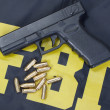 Stock Photo: 9mm handgun with ammo