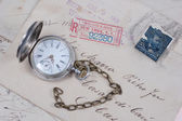 Old pocket watch and handwritten letters — Stock Photo