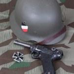 Luger P08 Parabellum handgun, helm and medal Iron Cross — Stock Photo #23230798