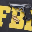 Handgun on FBI uniform — Stock Photo #24072671