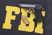 Handgun on FBI uniform — Stock Photo