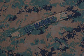 US Marines concept with service tapes and camouflaged uniform — Stock Photo