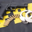 Stock Photo: Fbi concept with gun ammo and handcuffs