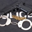 Security concept with gun ammo and handcuffs — Stock Photo
