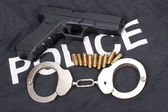 Police concept with gun ammo and handcuffs — Stock Photo