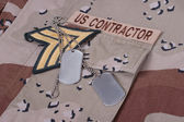 Us contractor uniform with dog tags and cartridges — Stock Photo