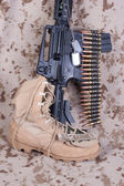 US Marines concept with firearms, boots and camouflaged uniform — Stock Photo