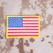 Stock Photo: US FLAG badge on desert marines uniform