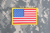 US flag on camouflage uniform — Stock Photo