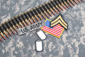 US ARMY concept on camouflage uniform — Stock Photo