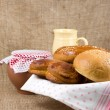 Stock Photo: Panary rolls lie on napkin in basket