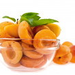 Stock Photo: Halves apricot in dish on background whole apricot