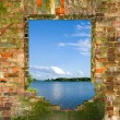 Window in a brick wall with a kind on the river — Stock Photo