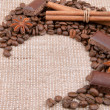 Background from coffee of bobs, chocolate, cinnamon and anise on — Stock Photo #33527485