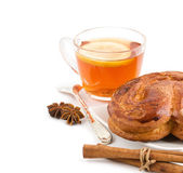 Tea with a lemon, roll, cinnamon, anise and tea spoon — Stock Photo