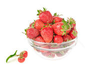 Berry of strawberry with a sheet on a background a dish with a s — Stock Photo