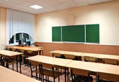 Class room with a school board and school desks — Stock Photo