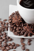 Coffee, grains, anise on a grey background — Stock Photo