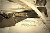 Old letters, inkpot, feather and photos — Stock Photo