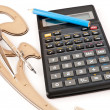 Pencil on a calculator, compasses and French curve on white — Stock Photo #33532187