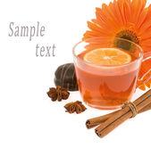 Black tea with a lemon on a background an orange flower — Stock Photo