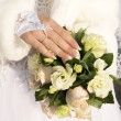 Hand of fiancee on a bouquet from roses — Stock Photo
