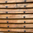 Background from wooden laths with nails — Stock Photo