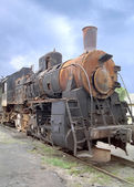 An old locomotive stands on a railway way — ストック写真
