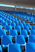 Blue seats in the grandstand of the stadium — Stock Photo