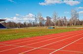 Pola i tory wyścigowe na stadion — Zdjęcie stockowe