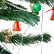 Stock Photo: Branch of the tree with Christmas beads bells and toys