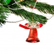 Stock Photo: Christmas bell and new year beads on the branch of a tree